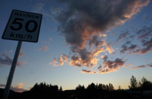 Sunset in Dease Lake, about 10 PM, the city street speed limit is typical of what we see going through most towns.