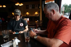 David and Marcus texting at dinner, we had cell service in Skagway.